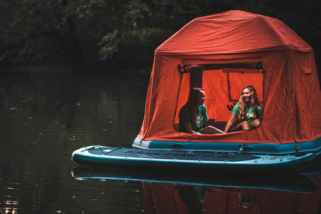 The Shoal Tent is described as a floating raft with a tent topper