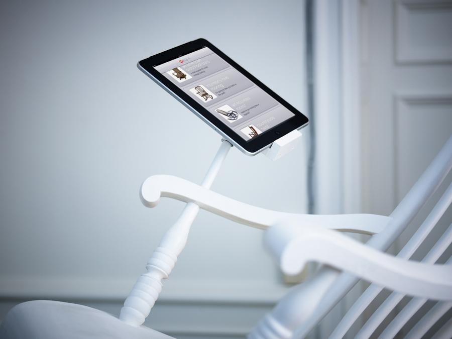 The iRock Rocking Chair features an arm-mounted iPad dock