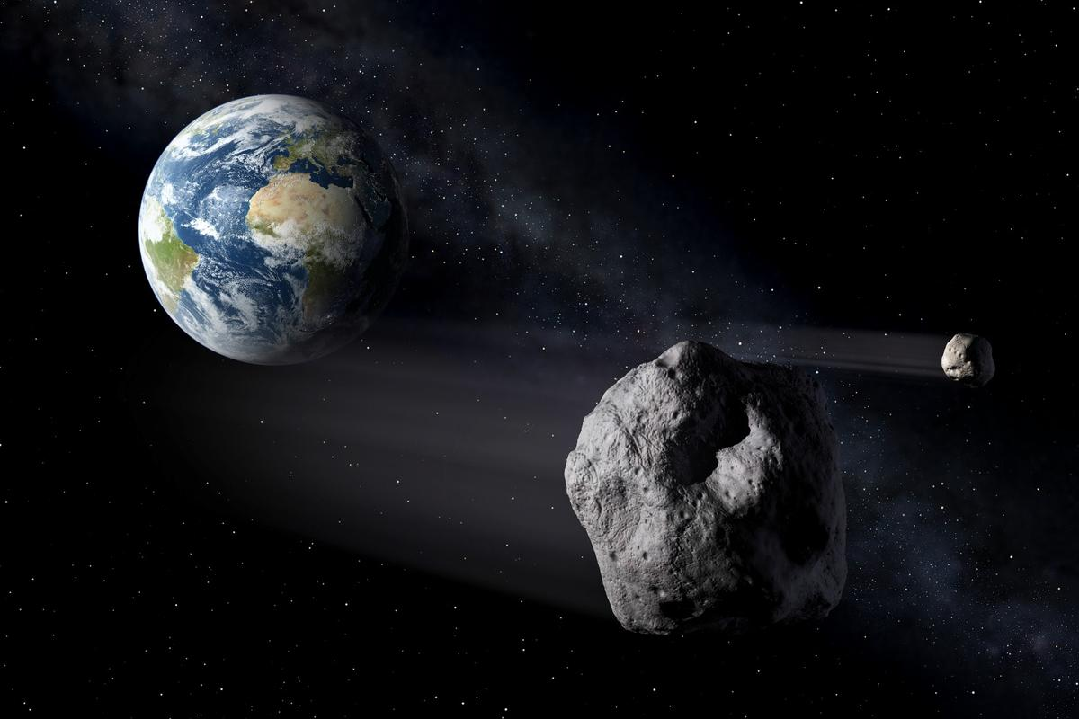An artist's illustration of an asteroid passing close by Earth