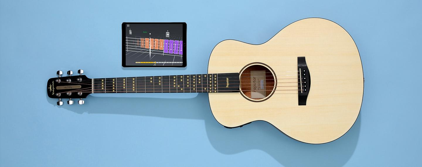 The app-based learning games will show students when to strum or pick, while the LEDs on the neck show them where to fret