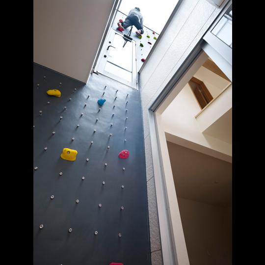 Rooftop access can be reached by the seven-meter (23-foot) climbing wall