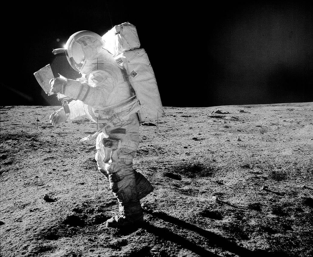 Astronaut Edgar Mitchell pictured walking across the Moon's surface in a spacesuit contaminated by lunar regolith