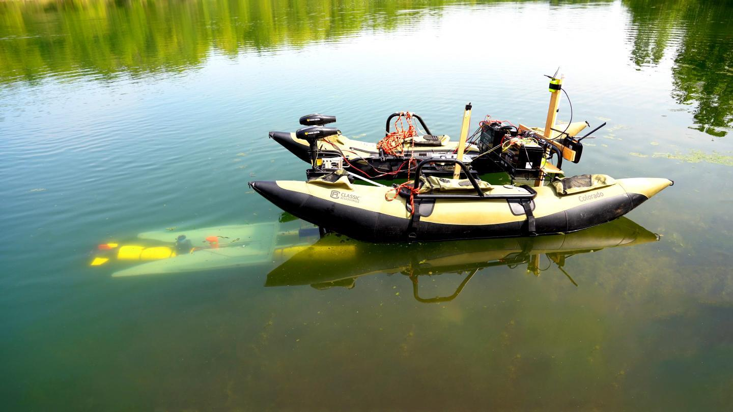 An underwater robot ports with the mobile docking station developed at Purdue University