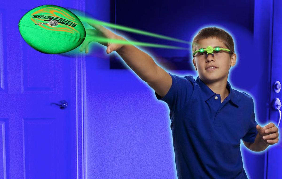 """The CyberFire Football Set incorporates a reflective foam ball and LED-equipped """"glasses,"""" which cause the ball to appear to glow green or red"""