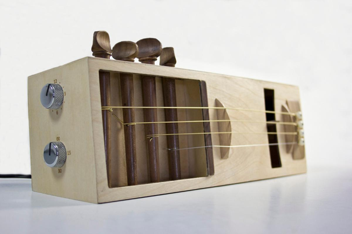 The Acoustic Alarm is a one-off alarm clock, that uses a motorized pic to pluck guitar strings in order to wake its user.