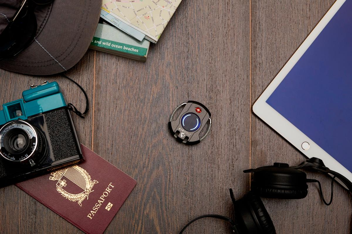 The AirBolt smart travel lock features location tracking, alarm, proximity alerts, and advanced security and privacy options