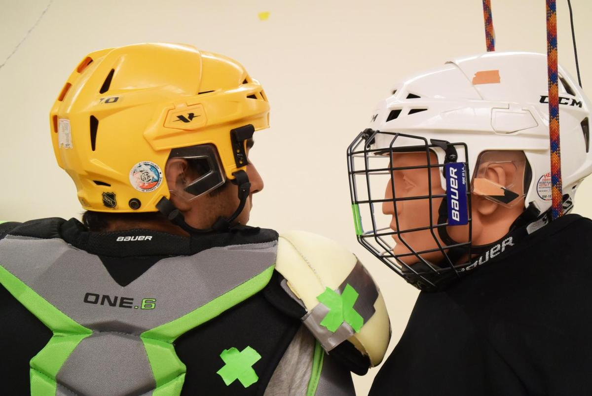 The scientists had a group ofhockey players deliver shoulder checks to the head of a sensor-equippedmannequin