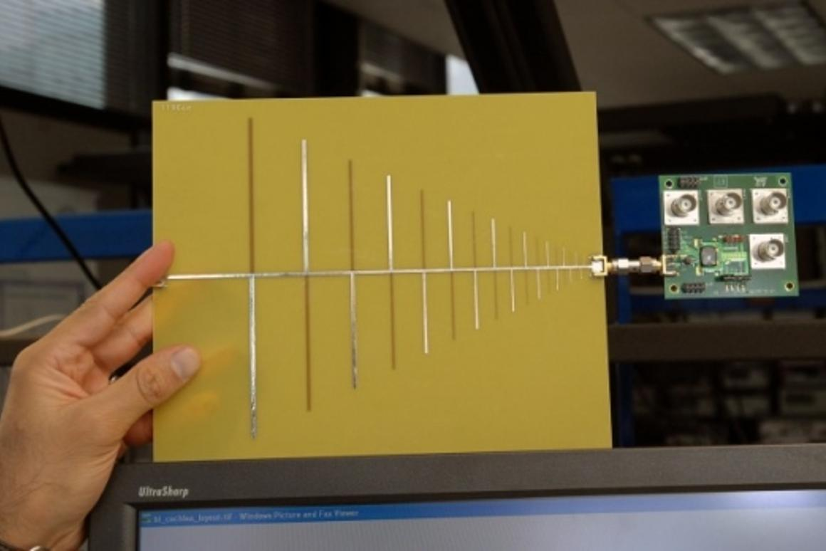 RF cochlea, a low-power, ultra-broadband radio chip attached to an antenna. (Credit: Donna Coveney/MIT)