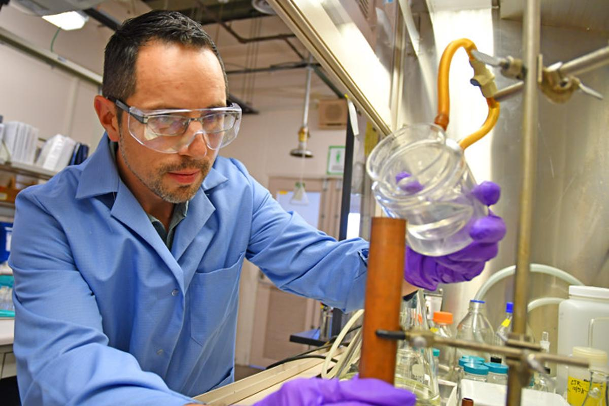 Explosives chemist David Chavez pours an example of melt-castable explosive into a copper mold at Los Alamos National Laboratory's Technical Area 9