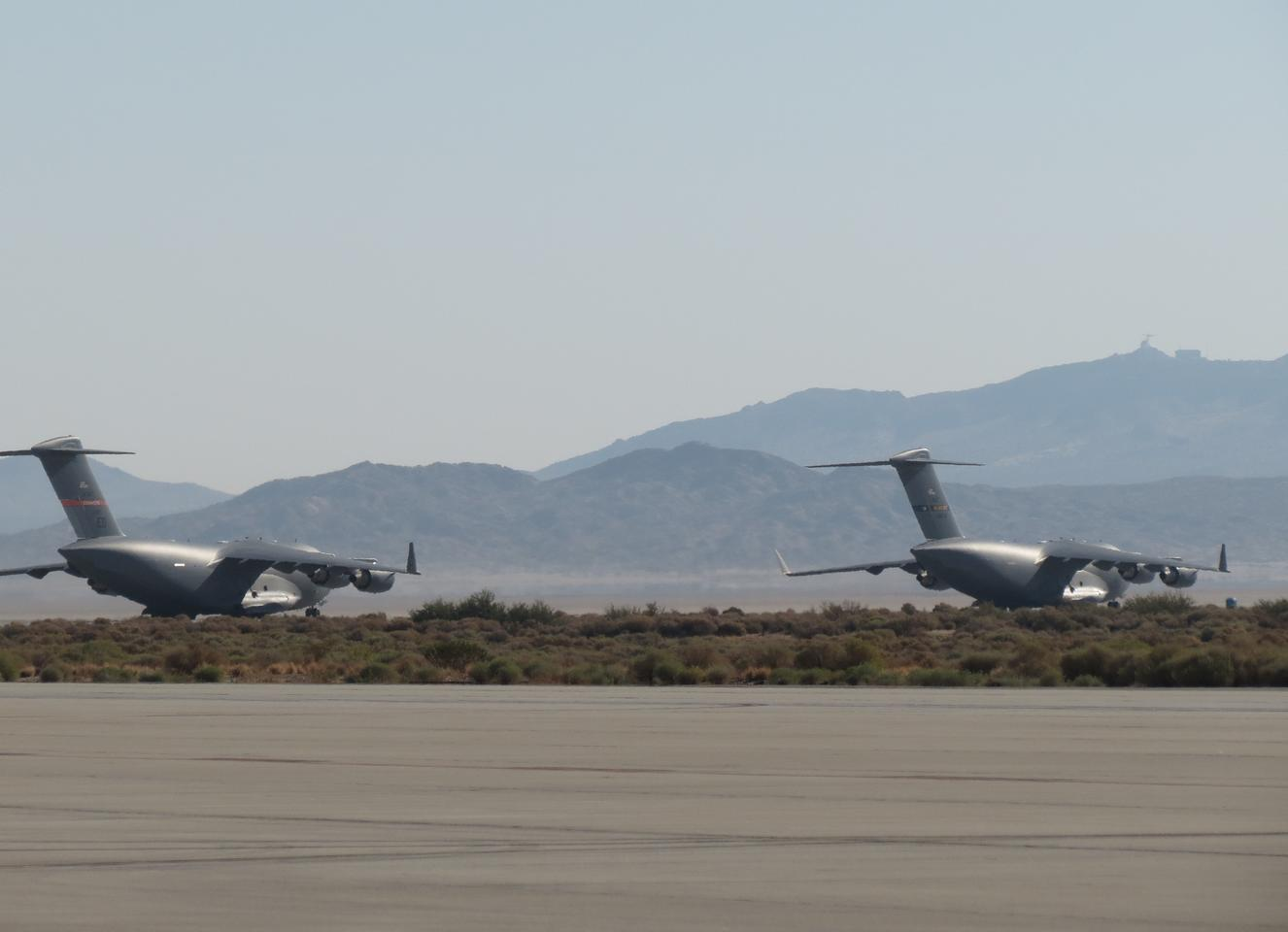 Tw0 C-17 cargo planes used in the $AVE vortex surfing tests (Image: US Air Force)