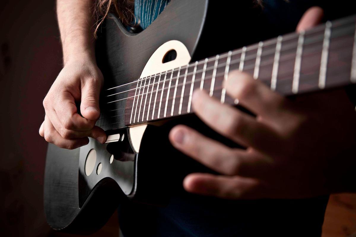 The Sensus smart guitar digitally enhances acoustic playing