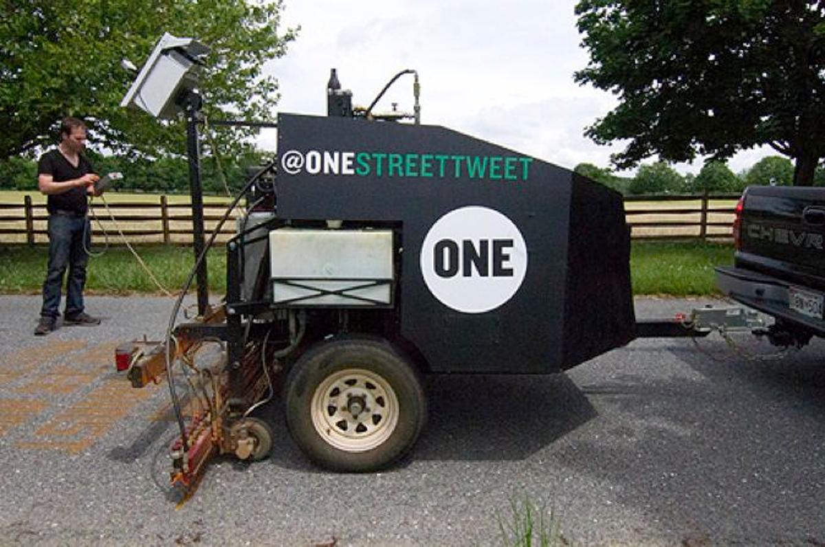 The One Street Tweeter is sort of like a giant towed inkjet printer, which paints Tweeted messages on the road