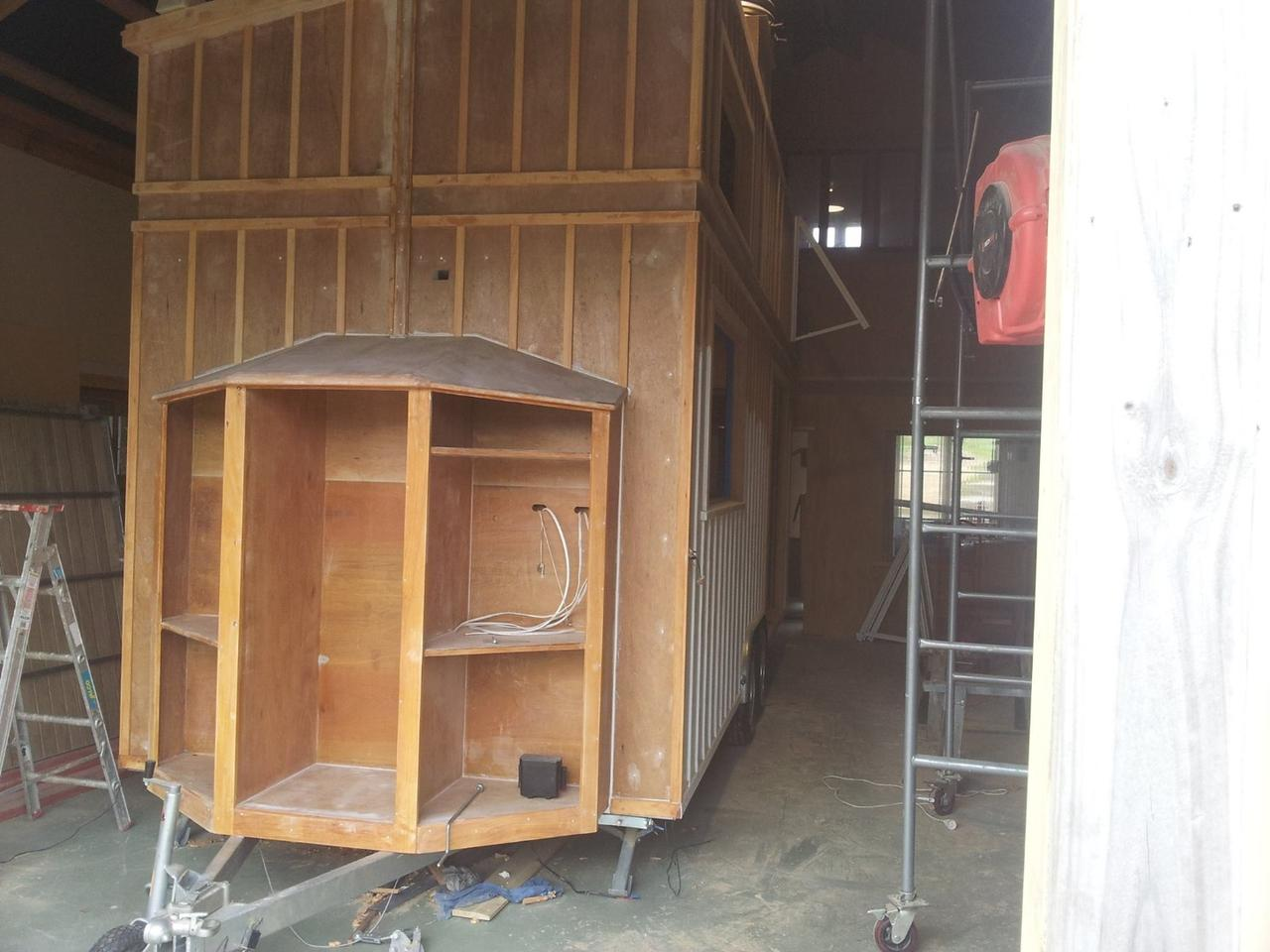The 23.95 sq m (257.8 sq ft) house was built using structural insulated panels (SIPs) made from plywood and foam