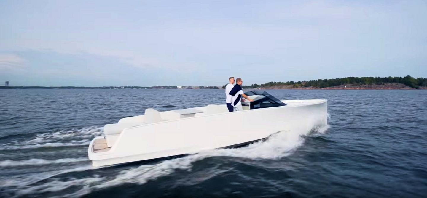 Finnish rapper Jare Tiihonen and former poker professional Jens Kyllönnen testing their Q30 electric day cruiser in Helsinki waters