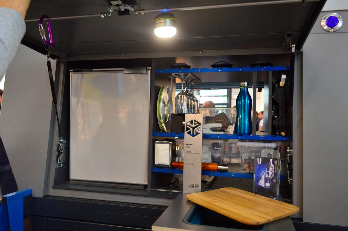 At ISPO, Fiftyten showed a camper truck configuration with slide-out countertop, sink and refrigerator