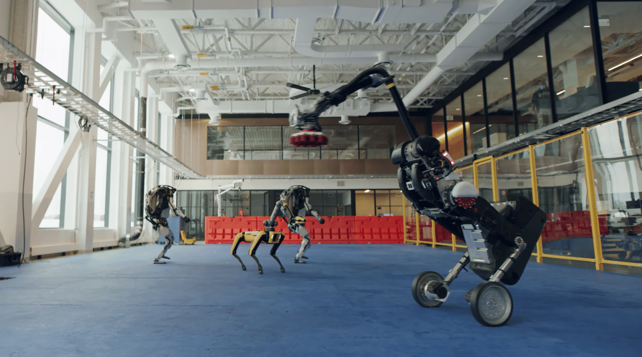 The video features the entire Boston Dynamics robot range dancing in sync