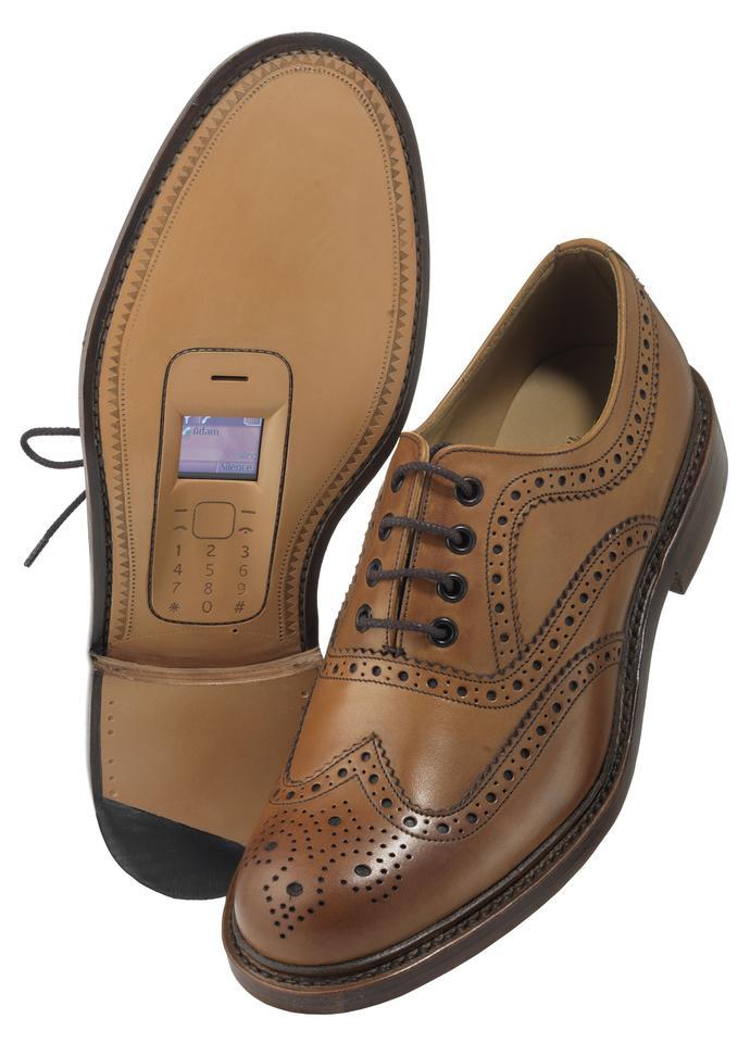 Brown leather wingtip Walkie Talkies