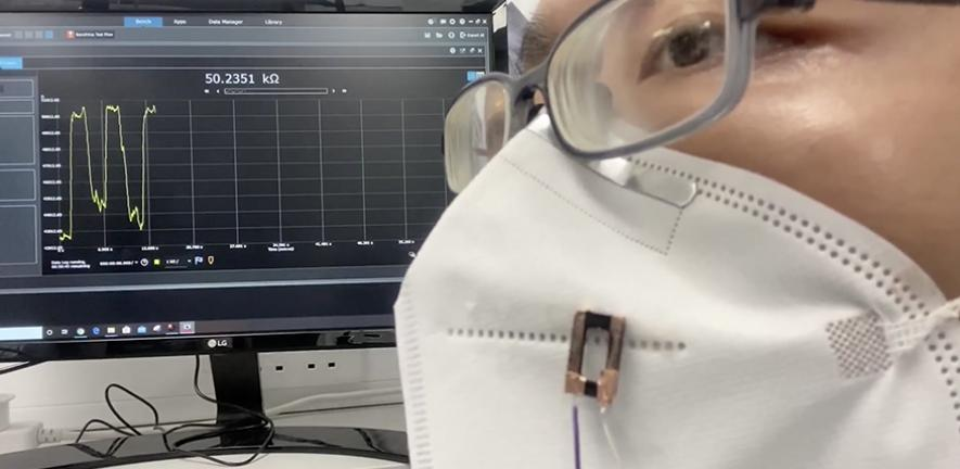 Scientists have developed a 3D-printed fiber than can be used to track breathing through face masks