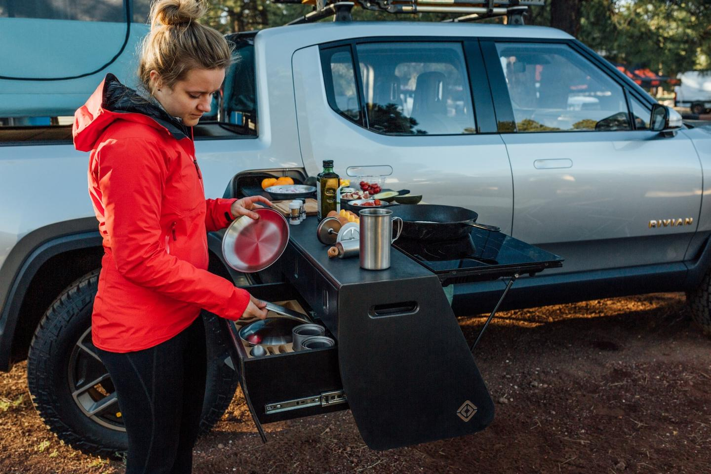Preparing some food and beverage on the Rivian R1T overland pickup