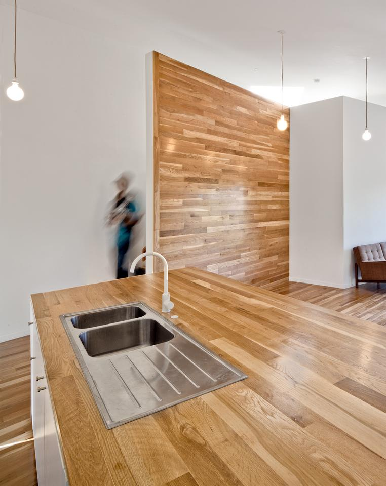 The kitchen countertop, feature wall, and floors are all constructed from white oak (Photo: Steve King)