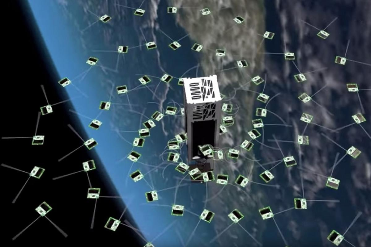 An artist's rendering of the deployment of ChipSats from a shoebox-sized CubeSat