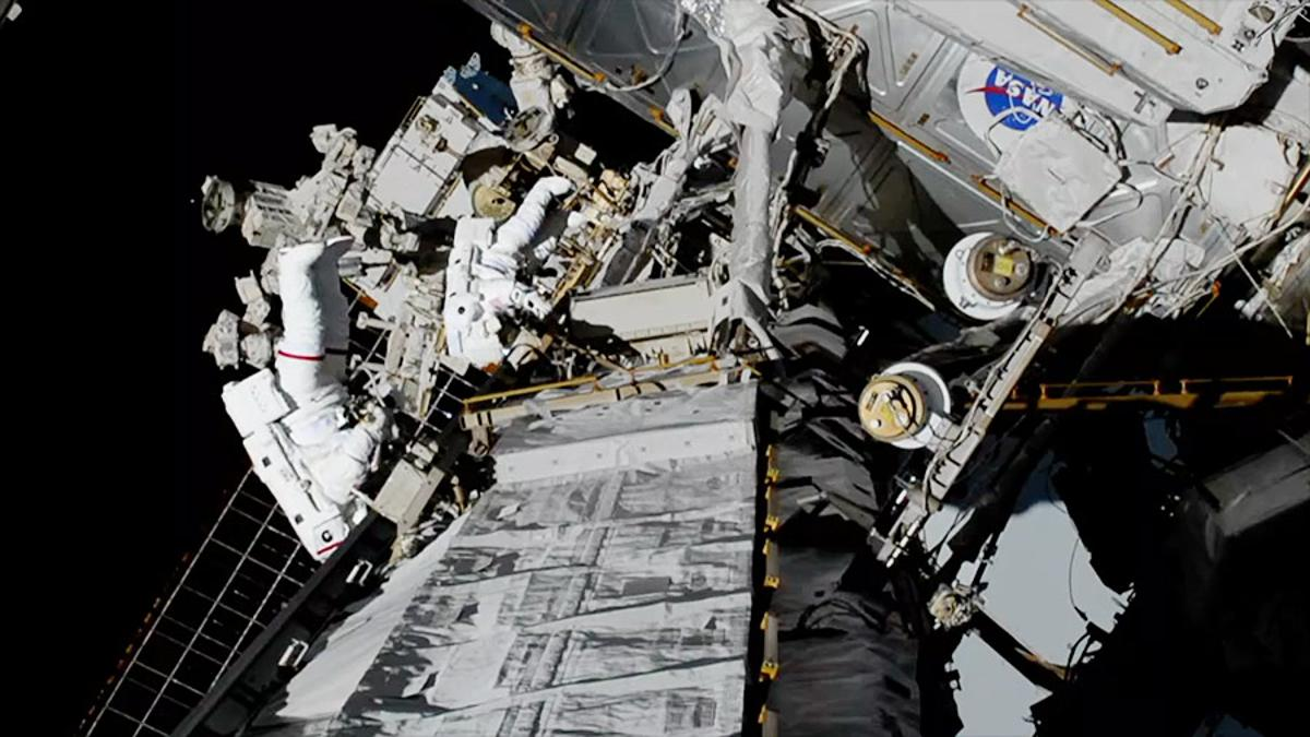 NASA spacewalkers Christina Koch (foreground, suit with red stripe) and Jessica Meir (suit with no stripes) replaced a failed battery charge-discharge unit with a new one during a 7-hour, 17-minute spacewalk
