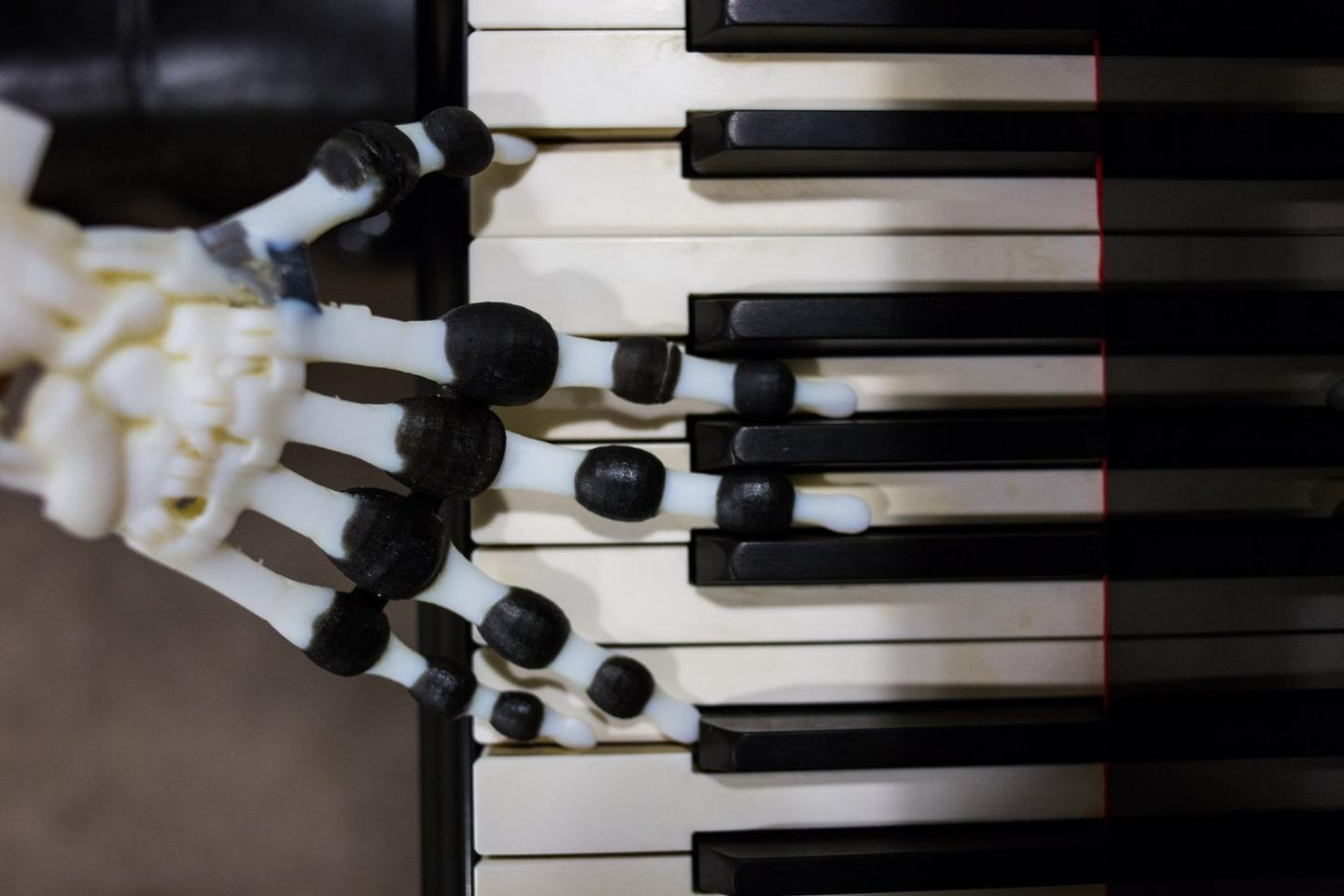 The soft robotic hand isn't going to win any piano playing competitions, but the researchers say that it could lead to the design of robots capable of more natural movement while cutting back on energy use