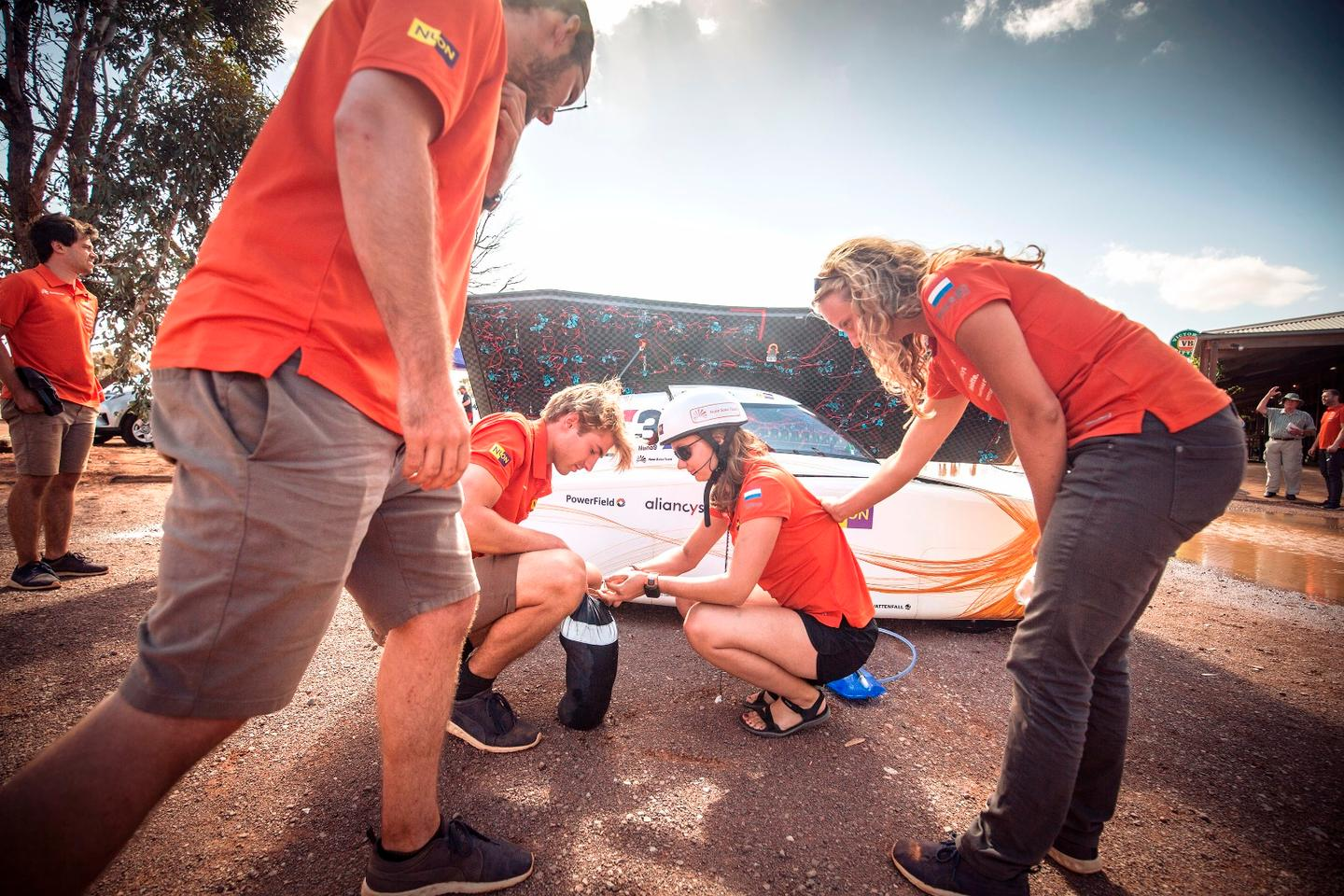 Members of the Nuon Solar Team in action during day four of the World Solar Challenge