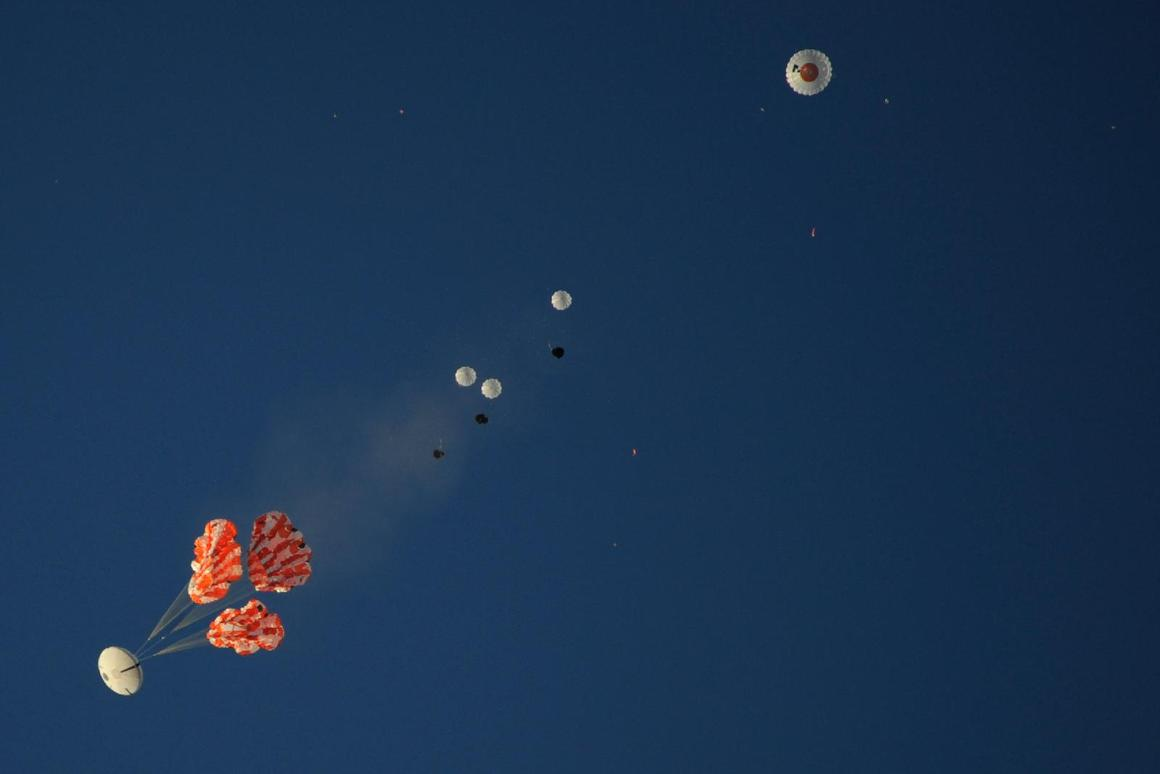 Three 300-pound main parachutes gently lower a mockup Orion capsule to the ground during a test at the U.S. Army Yuma Proving Ground in Arizona on Dec. 20 (Image: NASA)
