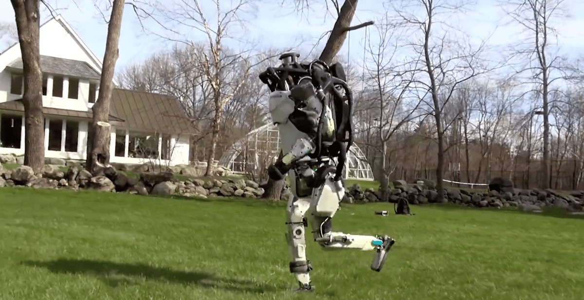 Boston Dynamic's humanoidAtlas robot is shown taking ajog through the woods in a new video