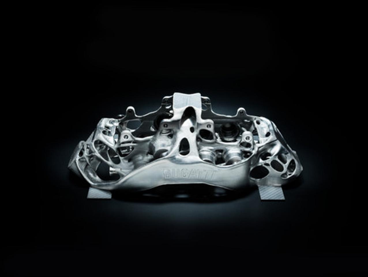This eight-piston monobloc brake caliper developed by Bugatti is the world's first brake caliper to be produced by 3-D printer