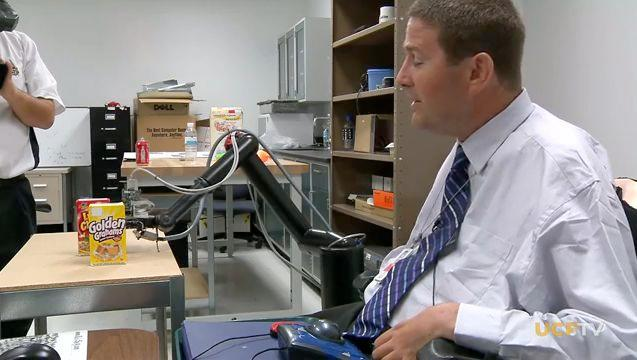 Test subject Bob Melia tries out the UCF robotic arm