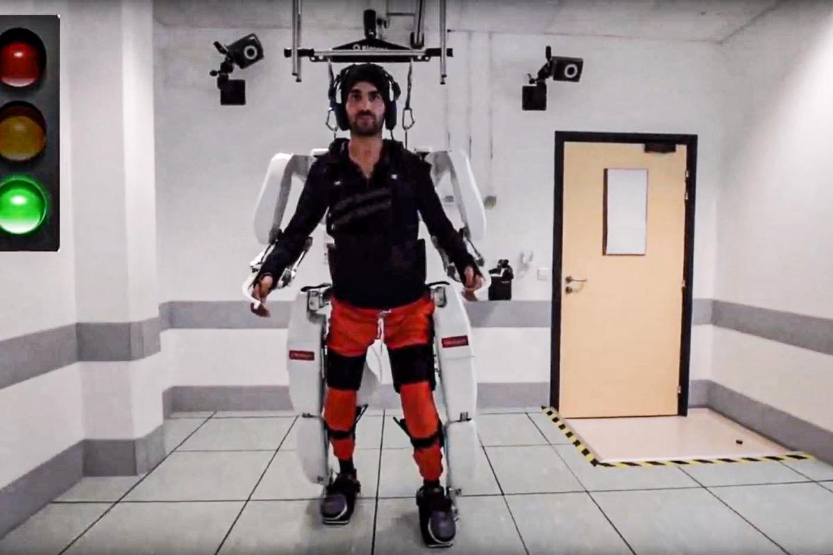 A quadriplegic patient walks using a brain-controlled AI exoskeleton