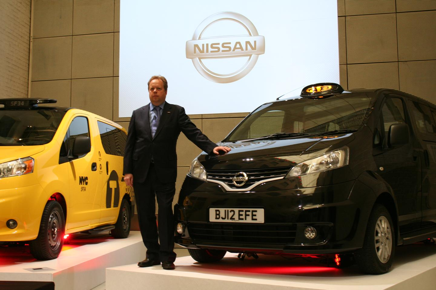 Nissan's Andy Palmer poses next to London's new NV200 black cab (Photo: Gizmag)