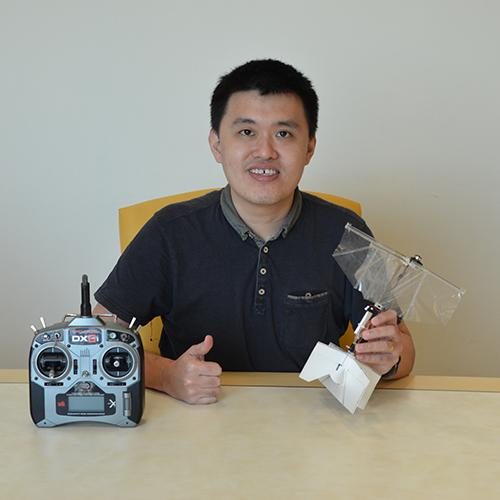 Study author Dr Yao-Wei Chin with the new swift-inspired flapping wing drone prototype