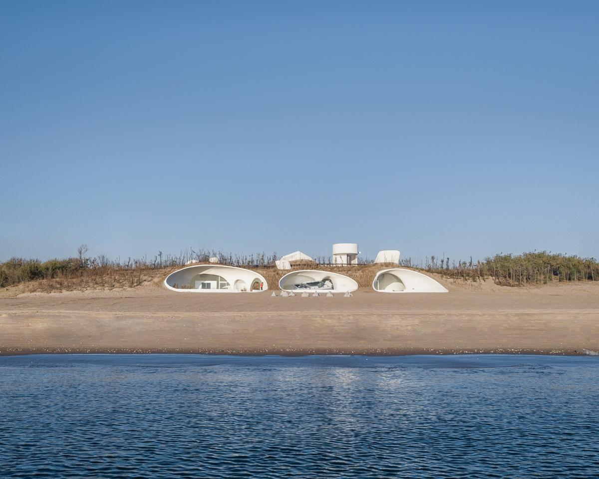 The UCCA Dune Art Museum consists of a complex concrete shell that was largely handmade  by locals