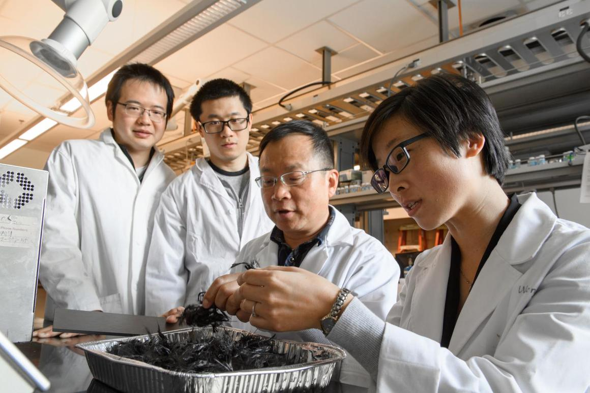 Prof. Jinwen Zhang (center) with his carbon fiber recycling research team