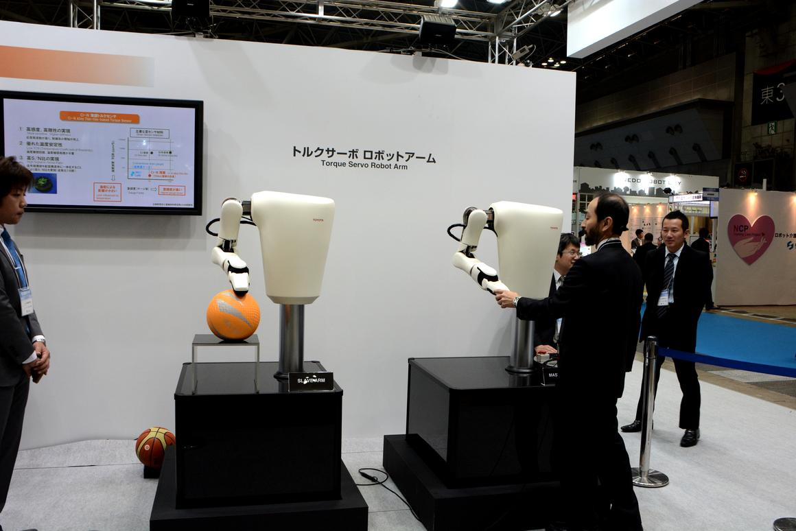 Toyota showcased its new torque servo module in a pair of compliant robot arms (Photo: Mike Hanlon, Gizmag)