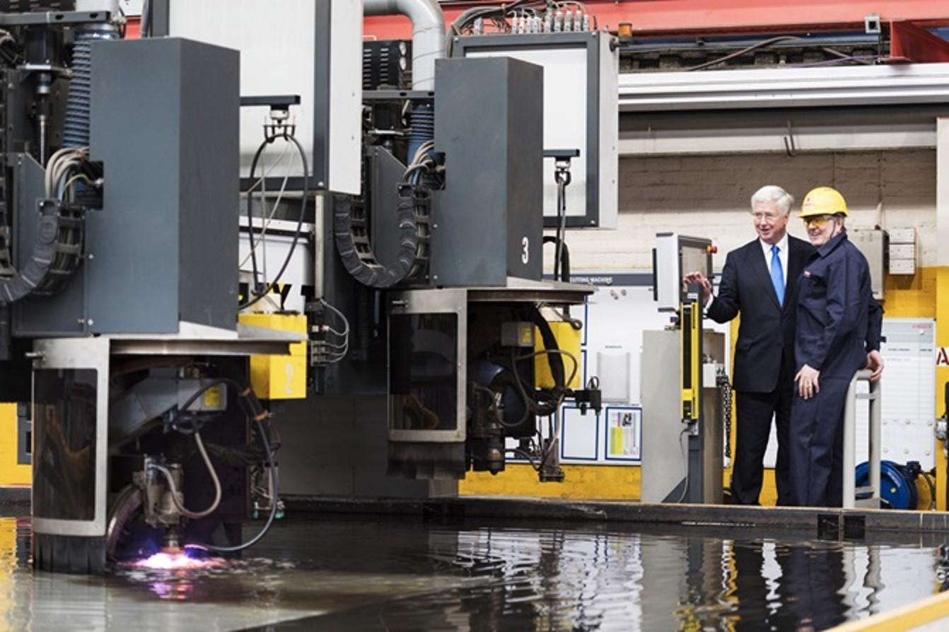 Defence Secretary Sir Michael Fallon throwing the switch to begin construction on HMS Glasgow