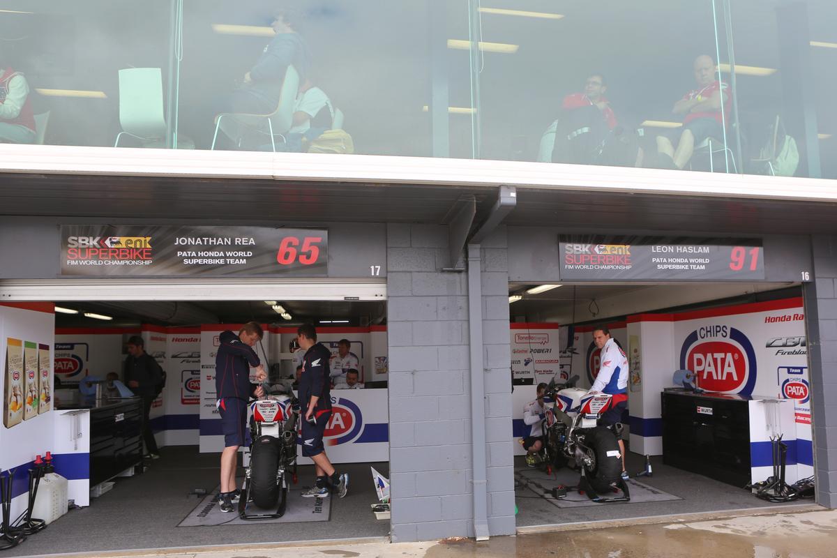 Honda's PATA World Superbike team below, and Honda corporate hospitality above