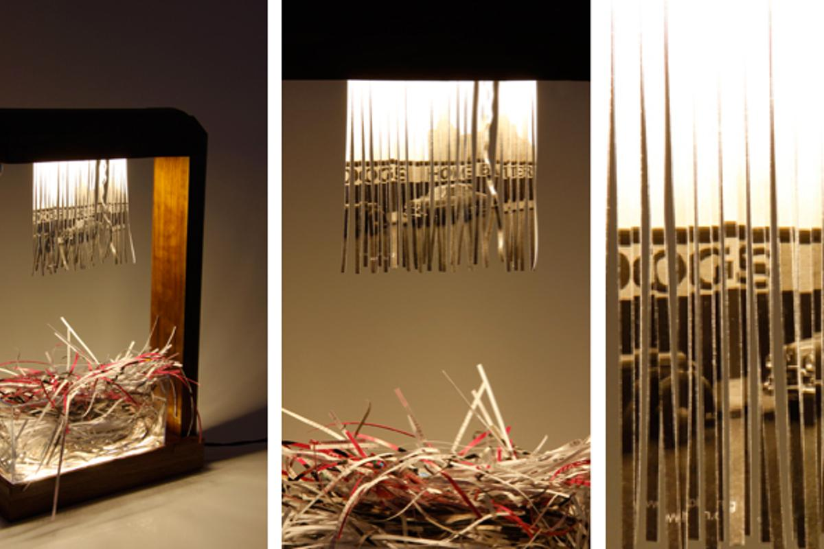 Eliminator by Merve Kahraman is a table lamp that uses the hanging curtain of shredded paper as a design feature