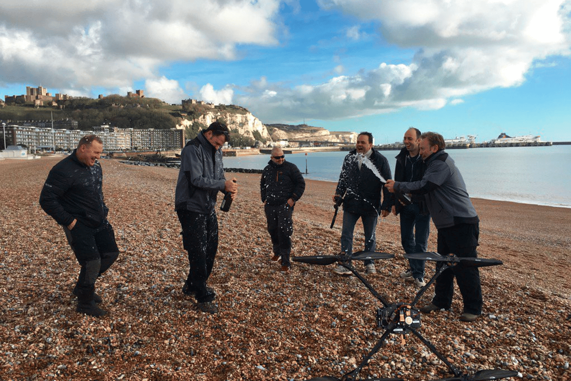 The Ocuair team celebrates after their custom drone flew across the English Channel
