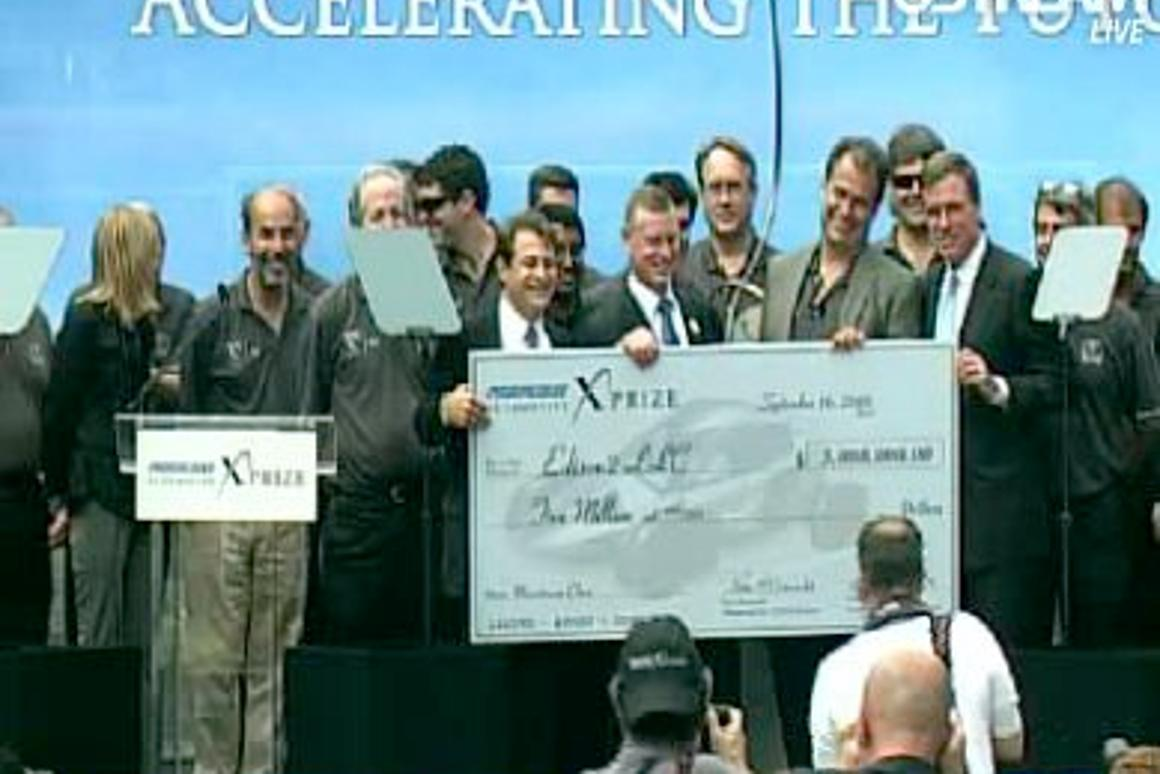 The Edison2 team accepting a cheque for US$5 million