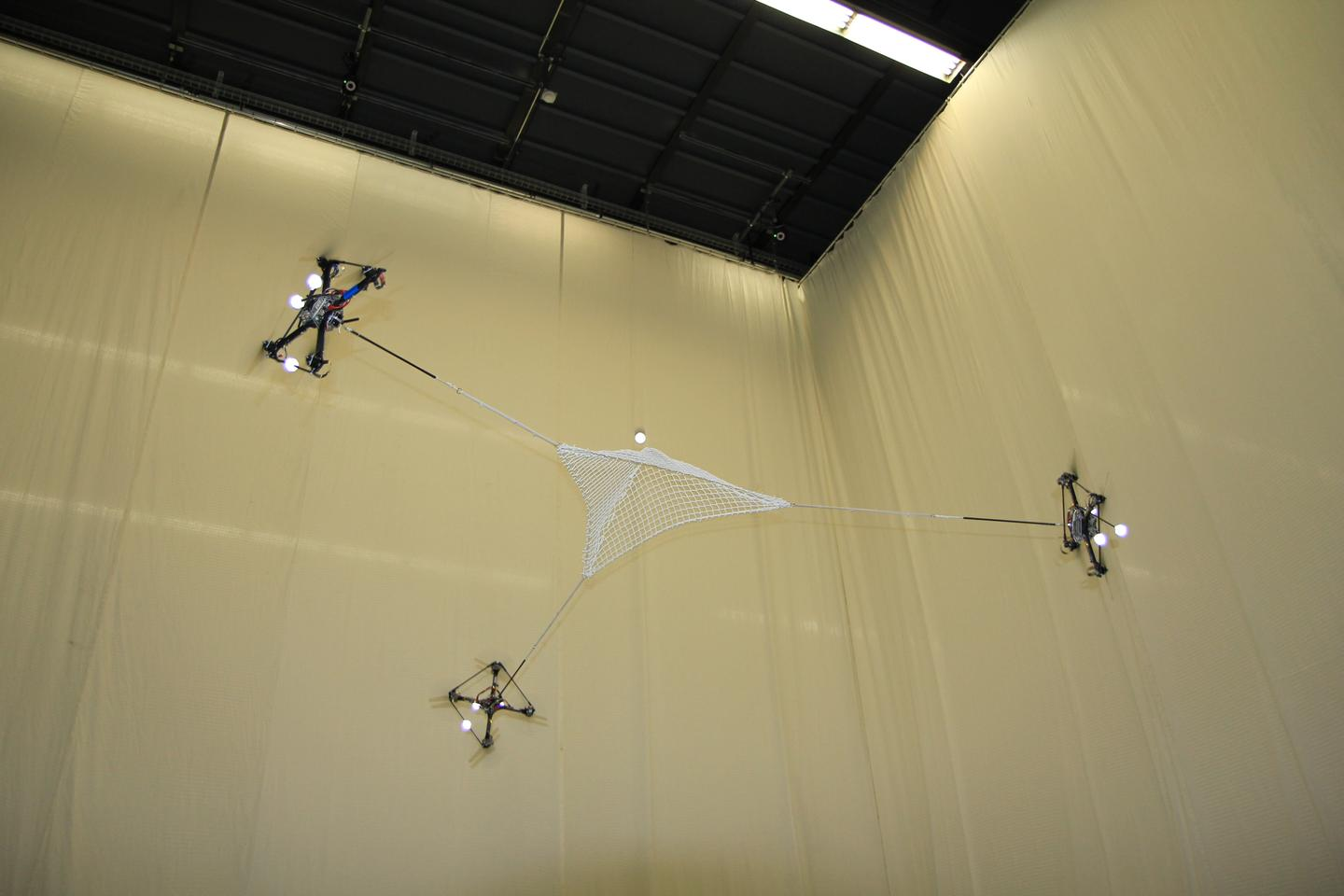 Flying quadrocopters at ETH Zurich's Flying Machine Arena play catch