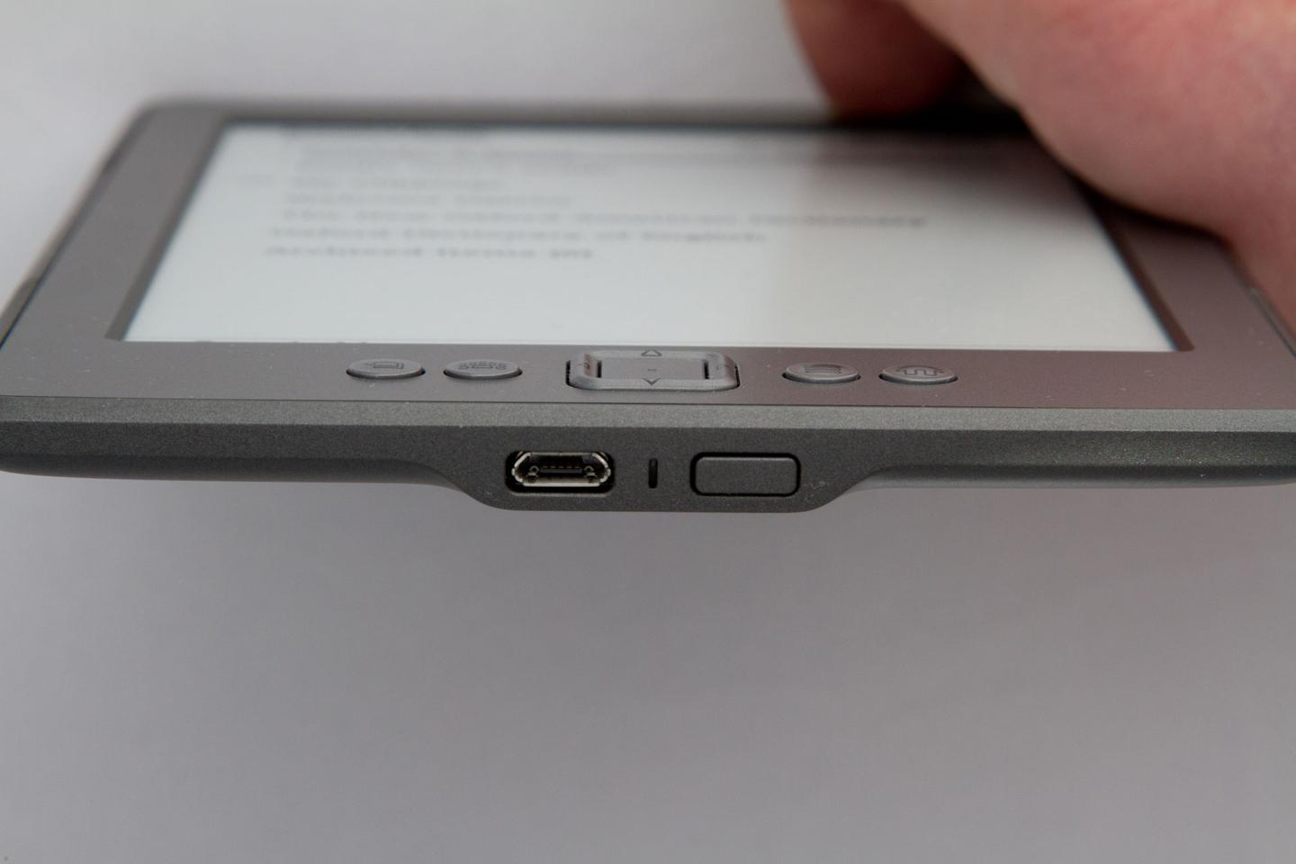 micro-B USB port and power button on the bottom of the 2011 Kindle