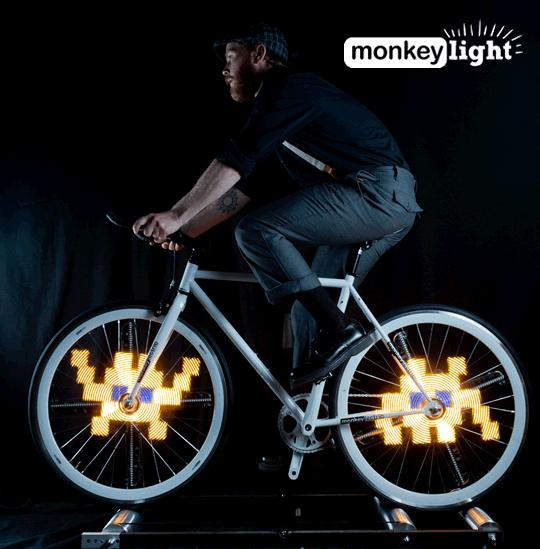 Monkey Light Pro is a set of LED bars that attach to a bicycle wheel and can be programmed to play colorful animations