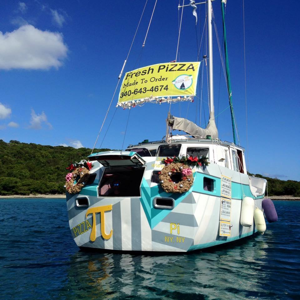 Sasha and Tara Bouis have transformed an abandoned aluminum sailboat into a floating pizza shop