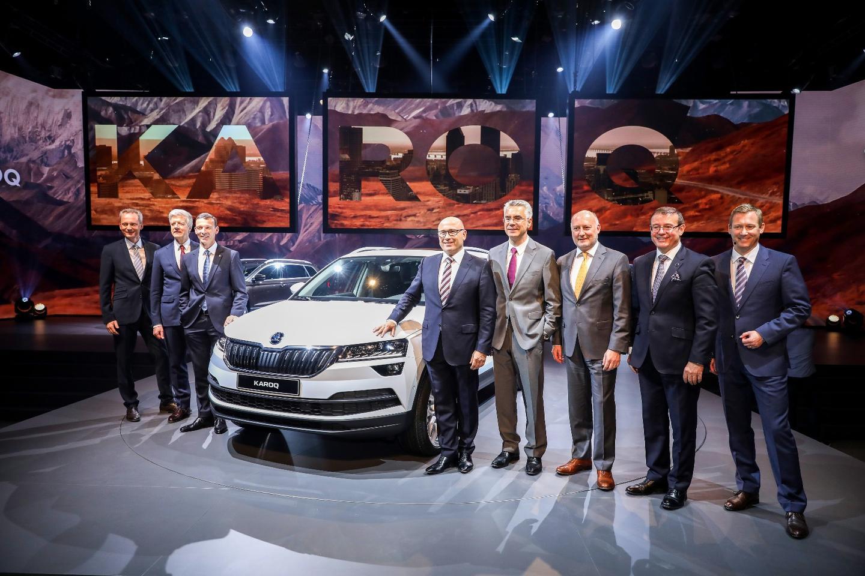 Skoda executives alongside the Karoq at its launch