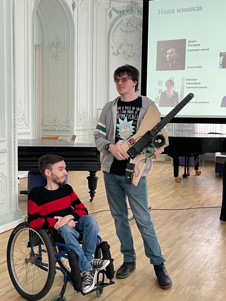 Denis Goncharov (left) and Maksim Matveitsov (right) demonstrating Noli's smart guitar prototype recently