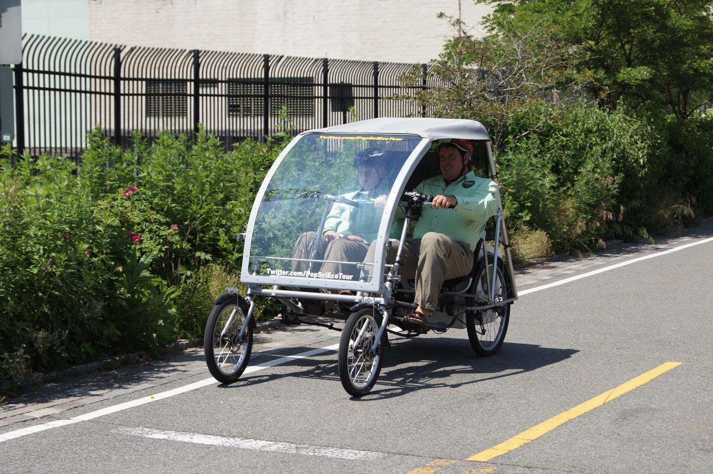 And they're off - Pierce Hoover and son Nash in their custom-built Hundred Watt Hybrid (Photo: Popular Science Magazine)